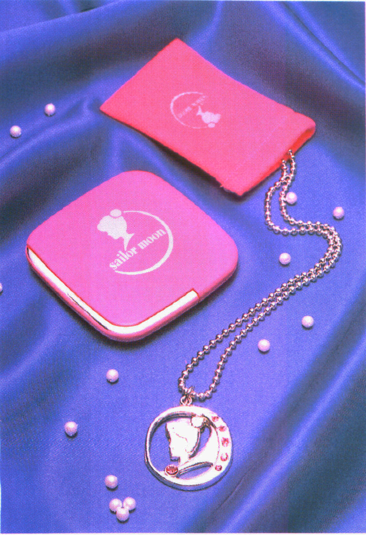 Sailor Moon merchandise: pendant and compact sold by Bandai