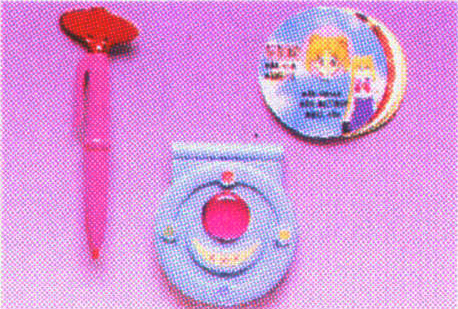 Sailor Moon merchandise: transformation pen, secret compact and info card on Usagi sold by Bandai