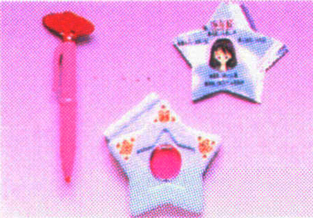 Sailor Moon merchandise: transformation pen, secret compact and info card on Sailor Mars sold by Bandai